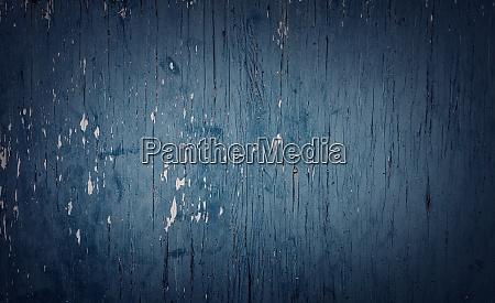 grauer holzhintergrund mit alten bemalten brettern