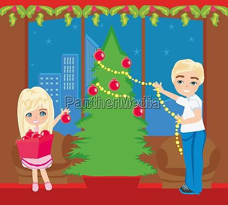 kinder schmuecken den weihnachtsbaum