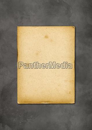 alte pergamentpapier textur isoliert auf beton