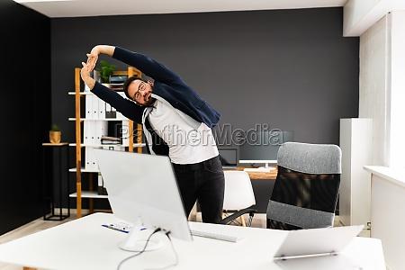 UEbung stretch standing near office desk