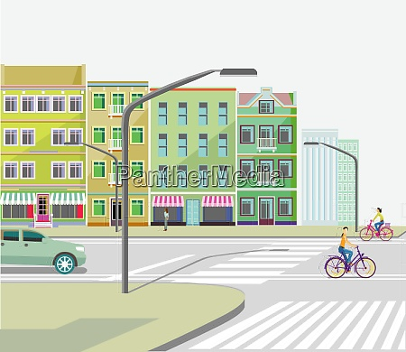 stadt mit strassenverkehr mehrfamilienhaeusern und radfahrern