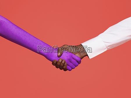 abstrakter handschlag auf rotem hintergrund