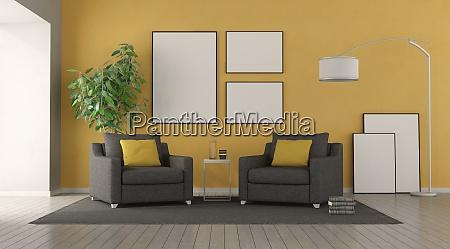 schwarzer sessel in einem modernen wohnzimmer