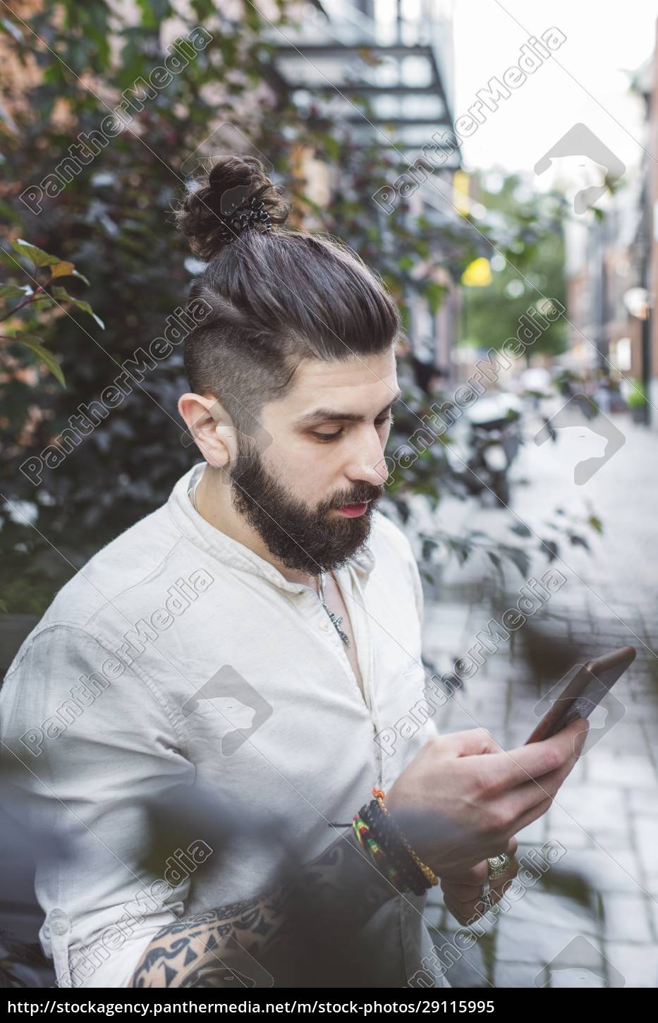 hipster, man, using, smartphone, while, standing - 29115995