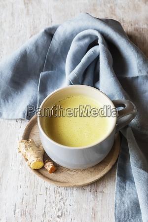 kurkuma-milch, mit, wurzel, von, serviette, auf - 29115819