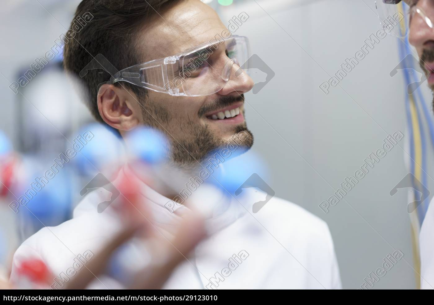 smiling, male, scientist, holding, molecular, structure - 29123010