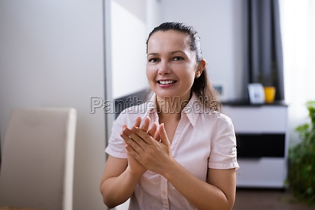 man clapping in video conference
