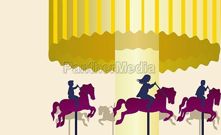 drei personen reiten auf karussellpferden