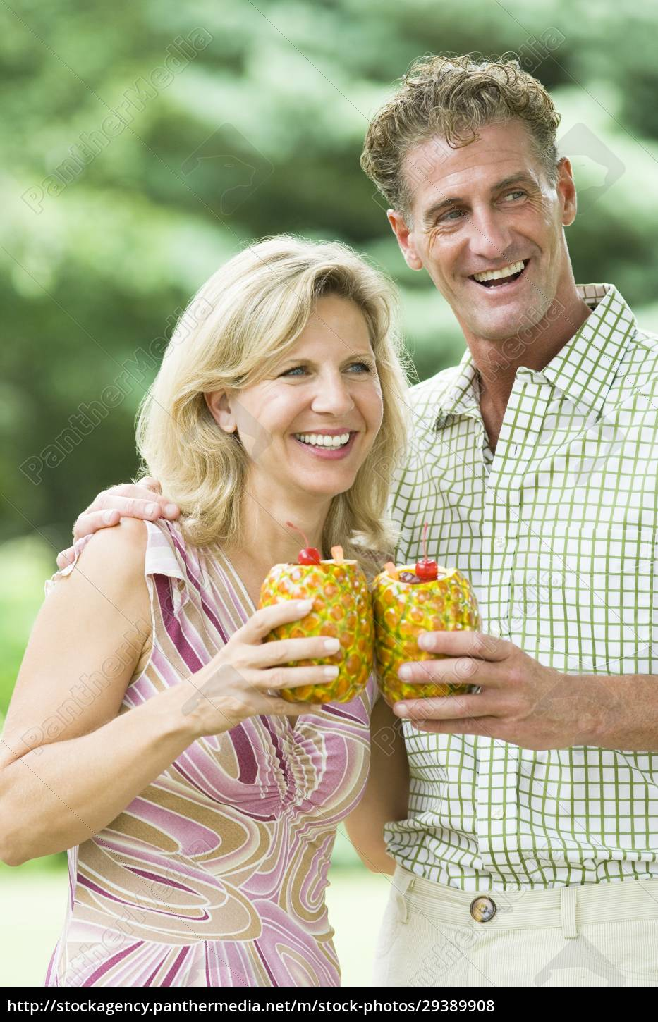 mature, couple, holding, pineapples, and, smiling - 29389908