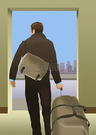 mann steht und traegt eine tasche