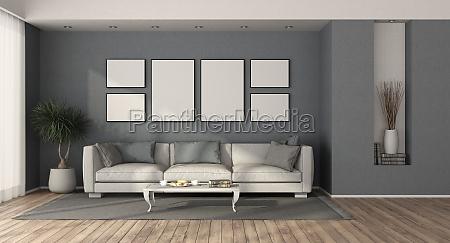 weisses modernes sofa in einem blauen
