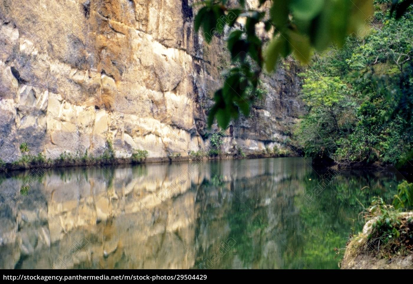 reflection, of, a, cliff, in, water - 29504429