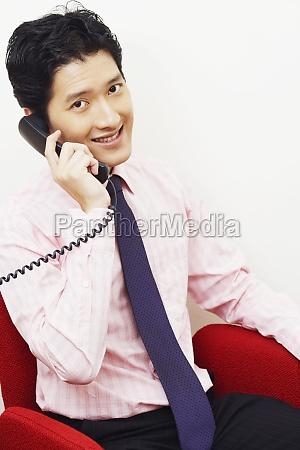 portrait, of, a, businessman, talking, on - 29599884