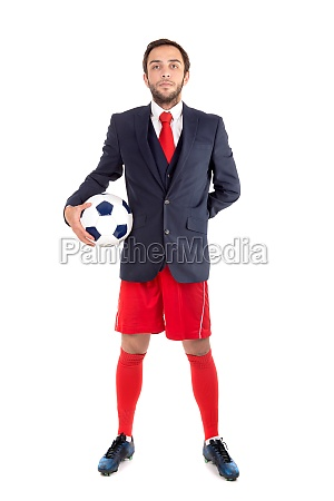 gluecklicher geschaeftsmann mit fussball