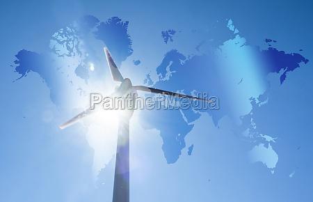 windkraftanlage gegen blauen himmel und sonne