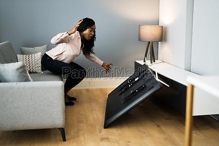 broken fallen tv