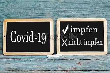 zwei tafeln mit der aufschrift covid