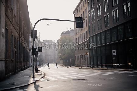crossing incidental people people in the