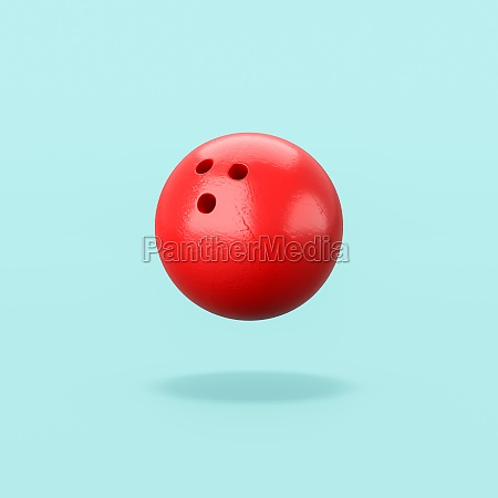 red bowling ball auf blauem hintergrund