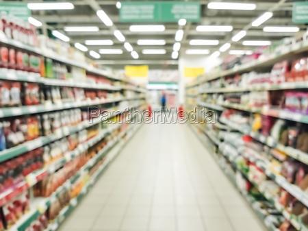 abstrakte verschwommene supermarktgang