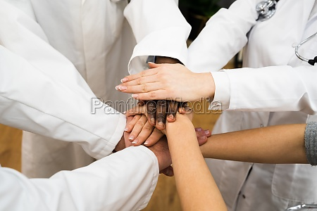 diverse medical staff team hands stack