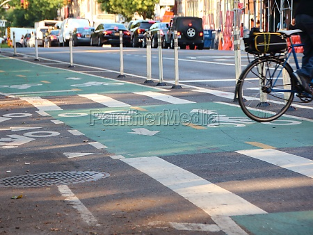 biker crossing cycle path in new