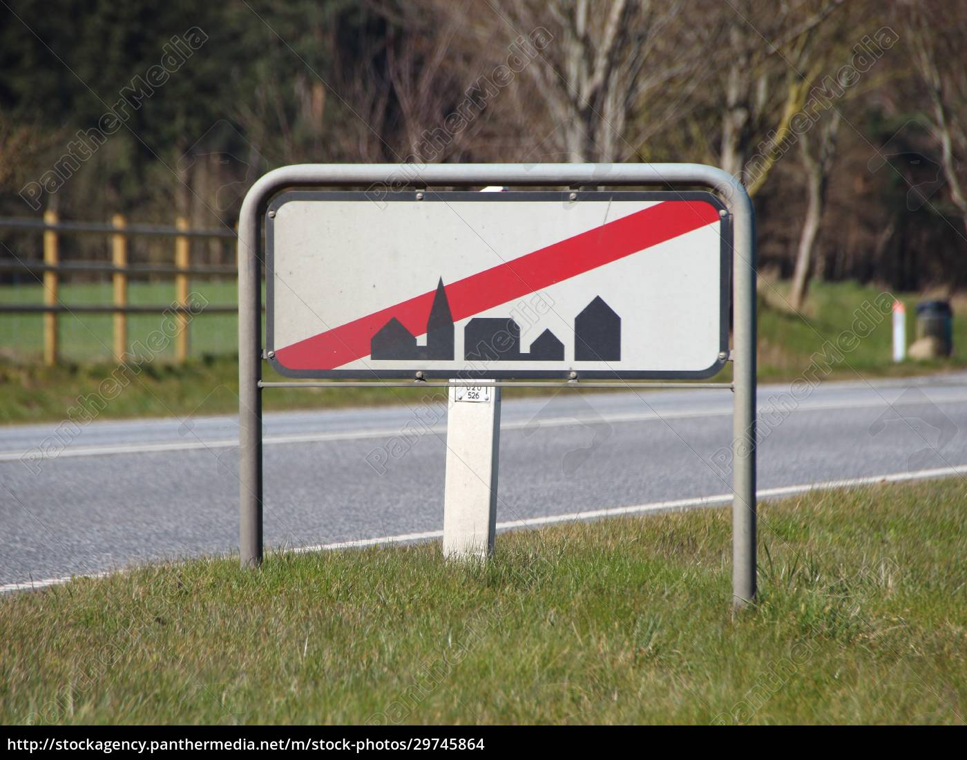leaving, town, sign, at, road, with - 29745864
