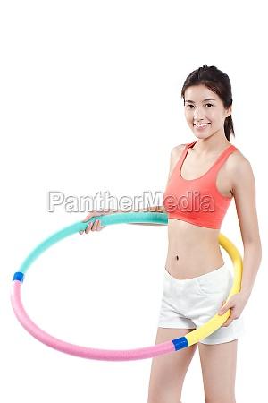 junge chinesin macht fitness