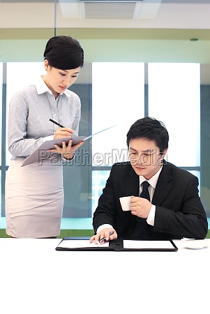 two, business, people, communicate, at, work - 29749399