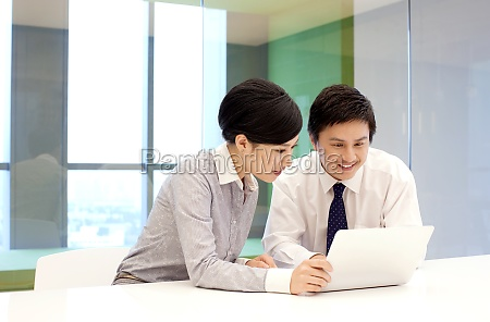 two, business, people, communicate, at, work - 29749400