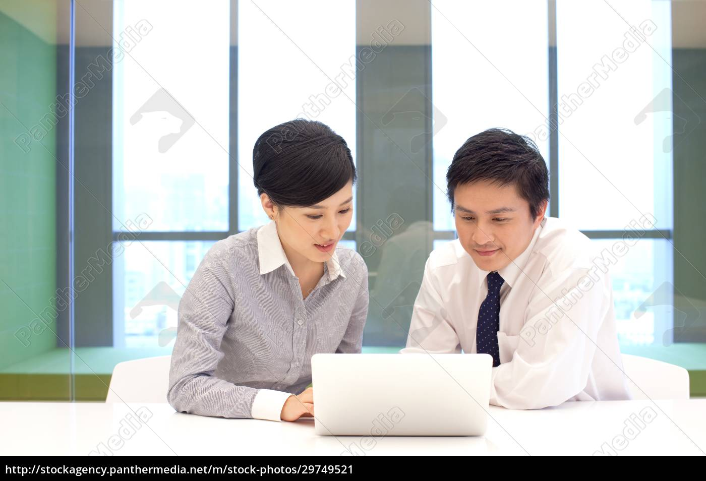 two, business, people, communicate, at, work - 29749521