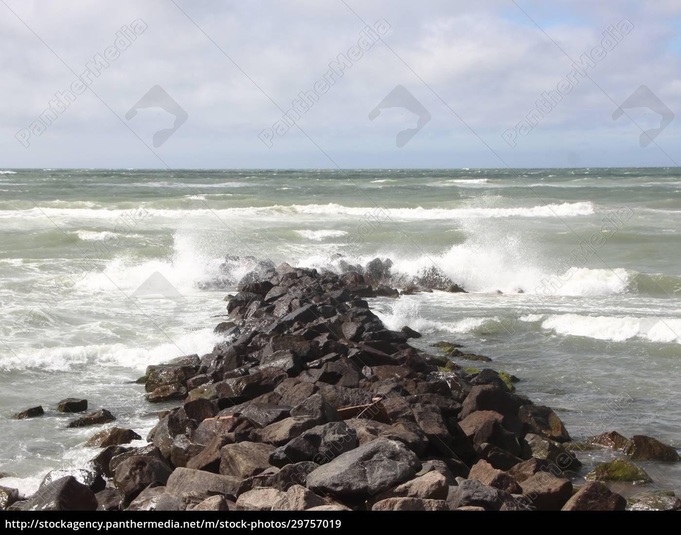 solid, breakwater, rocks, with, cloudy, ocean - 29757019