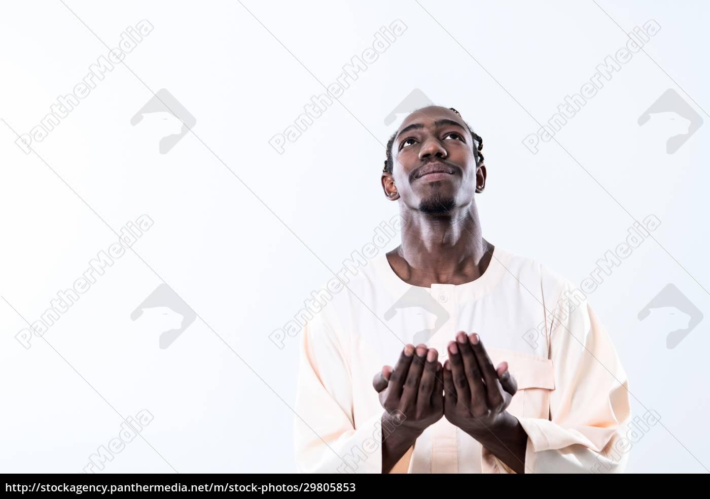african, man, pray, to, allah - 29805853