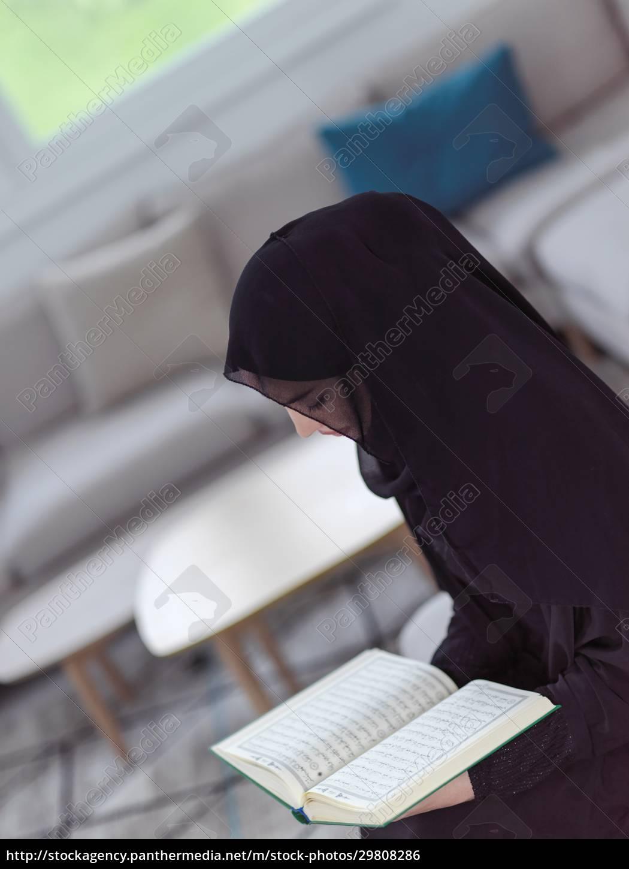 young, muslim, woman, reading, quran, at - 29808286