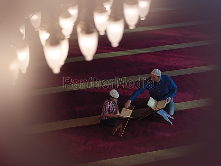 father, and, son, in, mosque, praying - 29811069