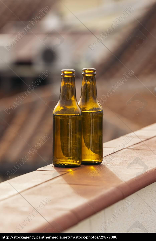 two, beer, bottles, on, balcony, wall - 29877086