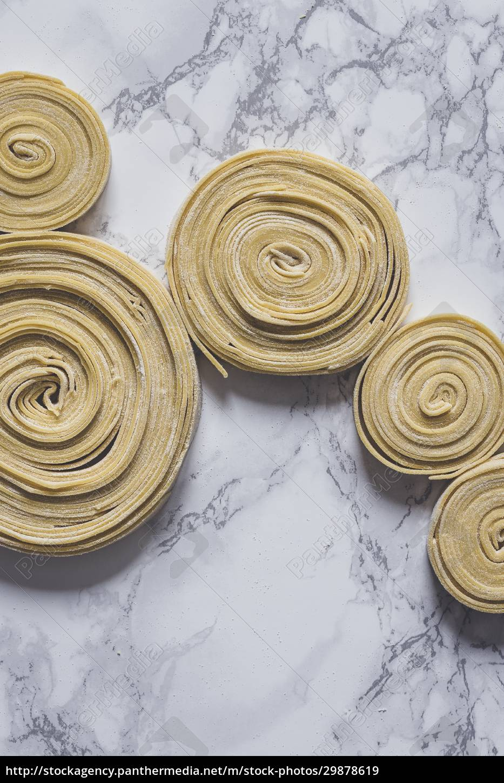 fresh, uncooked, pasta, swirls - 29878619