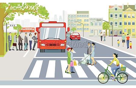 strassenverkehr mit bushaltestelle fussgaenger auf zebrastreifen