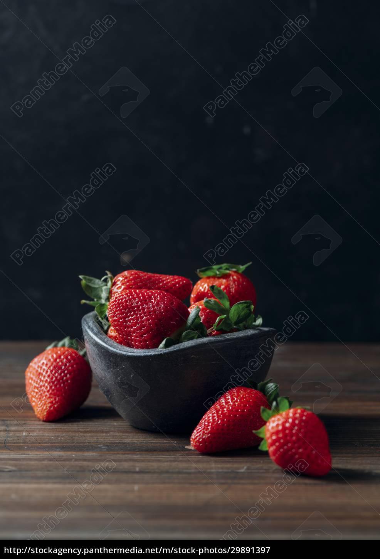 fresh, ripe, strawberries, in, black, concrete - 29891397