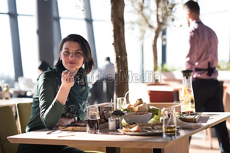 young, woman, at, a, restaurant - 29936221