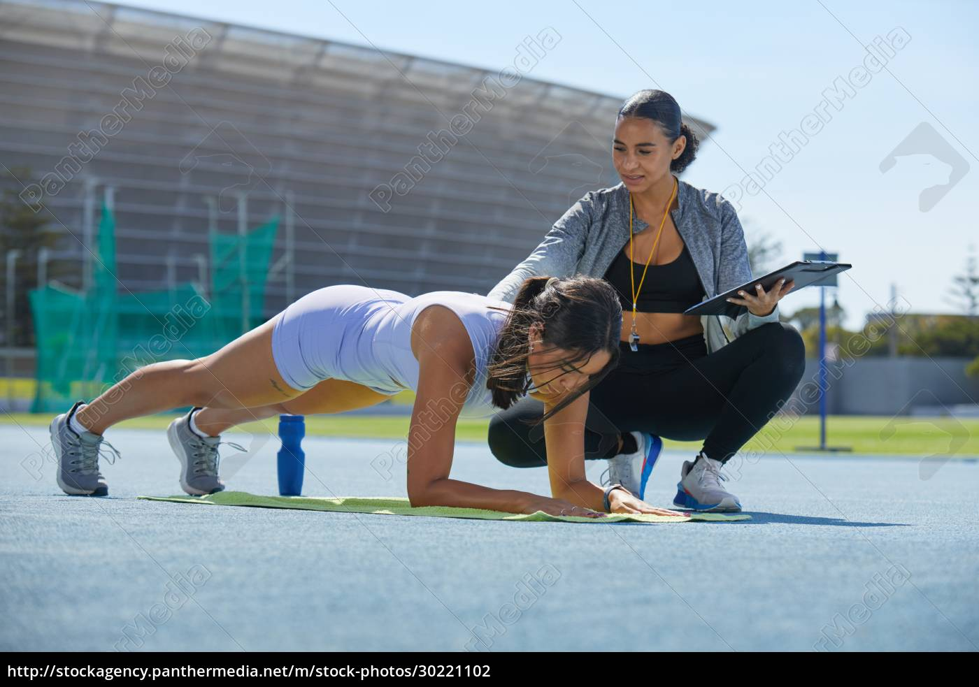 trainer, helping, female, track, and, field - 30221102
